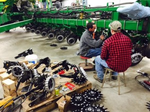 Spring will soon be upon us!  Andrew and Ryan working on the Deere planter rebuild project.