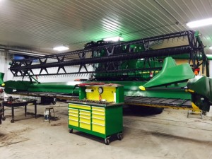 The transition from Fall to Winter often includes maintenance of harvest equipment.  This soybean draper head is being inspected before winter storage.