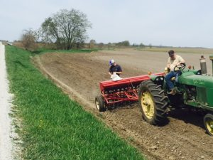 Blake and Leonard seeding a newly-graded ditch.